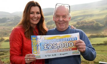 Saturday's Street Prize winner, Michael MacPherson in Rogart, alongside Judie McCourt and his £25,000 cheque