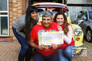 1. £25,000 winner Ajay, his daughter Joiti and People's Postcode Lottery ambassador Judie McCourt celebrate Ajay's win