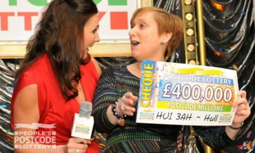 Judie McCourt with lucky winner Elaine Lamping and her £400,000 cheque