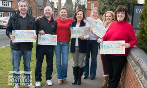 Postcode Lottery Ambassador Judie McCourt with our lucky Derbyshire winners and their cheques