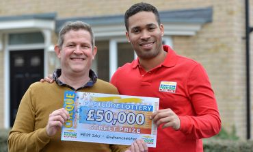 Godmanchester player Andy Tibbott, standing alongside Danyl Johnston, is ecstatic with his £50,000 win