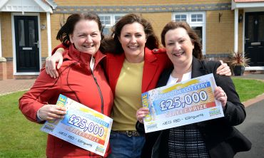Killingworth winners Xena Marshall and Wendy Johnson smile proudly with People's Postcode Lottery Ambassador Judie McCourt
