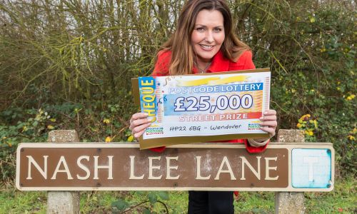 People's Postcode Lottery presenter Judie McCourt with a lovely £25,000 cheque for one lucky winner