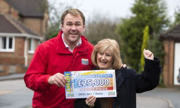 Wendy Beric from Derby cheers her win with Scott Quinnell
