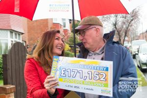 5. Judie handing over another amazing cheque to Postcode Millions winner David