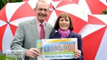 Mari and Robert Place, parents of our £400,000 winner, collecting his cheque