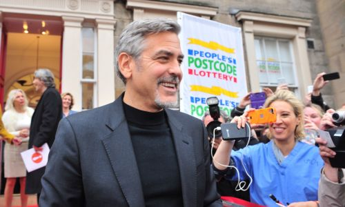 George Clooney visited People's Postcode Lottery to receive a £175,000 cheque on behalf of charity 'Not On Our Watch'