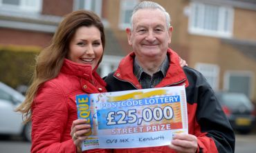 Our £25,000 Kenilworth winner Derrick Ward alongside People's Postcode Lottery presenter Judie McCourt