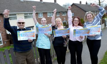 Five of our fantastic Ilkeston winners celebrate with People's Postcode Lottery presenter Judie McCourt
