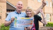 £25,000 winner Richard Toplis celebrates with his wife Sue
