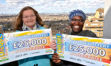 Brenda Mackey and Fatima Kallon of London both show off their £25,000 cheques