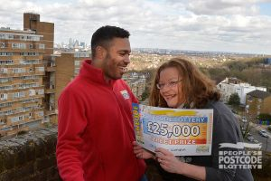 03. Danyl Johnson handed Brenda the cheque of a lifetime