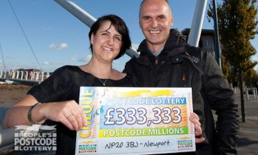 Winner Jacqui Howell and husband Dave with their £333,333 cheque