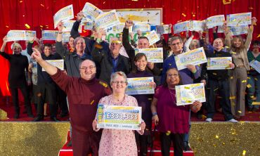 £333,333 winner Susan and her fellow Uckfield winners celebrate with their life-changing cheques