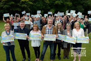 02. A group of big winners celebrate with their massive cheques