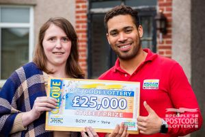 02. Catherine and Danyl happily displaying her £25,000 cheque