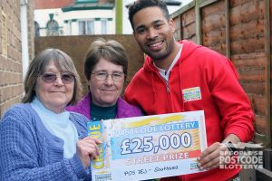 01. People's Postcode Lottery Ambassador Danyl Johnson revealing a winning cheque to Sarah Armstrong and her friend Jan