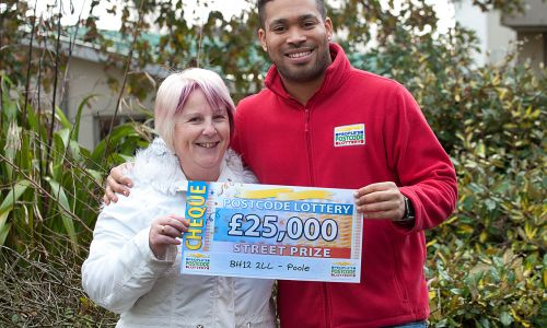 People's Postcode Lottery ambassador Danyl Johnson with £25,000 Street Prize winner Sandra