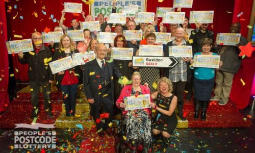 Happy winners in Basildon celebrate with their life-changing cheques