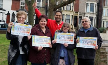Our four Southsea winners, Theresa, June, Sarah and John, celebrate with Danyl Johnson