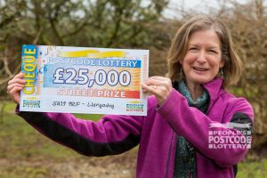 Heather with her fantastic Street Prize cheque