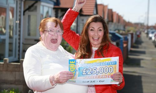 Judie McCourt with lucky winner Mary and her whopping £25,000 cheque