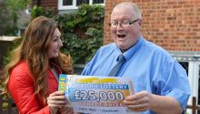 Judie with lucky Chatham winner Bevan and his £25,000 Street Prize cheque