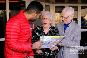 Ina was very surprised when Danyl Johnson presented her with her £30,000 cheque
