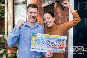 Lucky Knott End-on-Sea winner Robert and his wife Emma celebrating their win