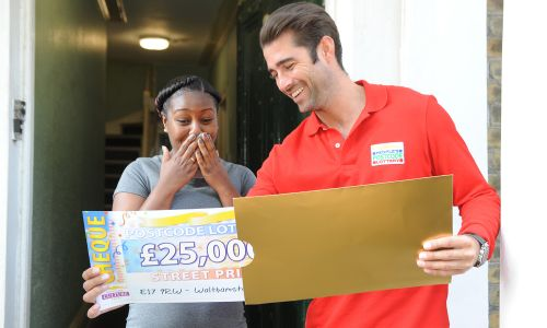 New ambassador Matt Johnson surprising winner Racquel with her £25,000 cheque