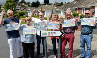 Some of the lucky June Postcode Millions winners from Torquay and their cheques