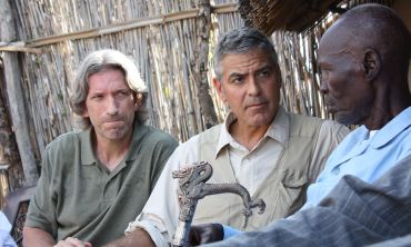 The Sentry's co-founders, John Prendergast and George Clooney meet with a tribal elder in Abyei.  Photo: Matt Brown/Enough Project