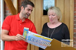 02. Christina Chamberlain happily accepting a £25,000 cheque from Matt