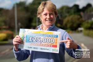 Appleton Street Prize winner Kate with her whopping £25,000 cheque