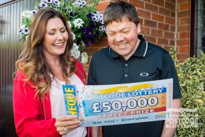 Street Prize Presenter Judie McCourt handing Paul his fantastic cheque for £50,000