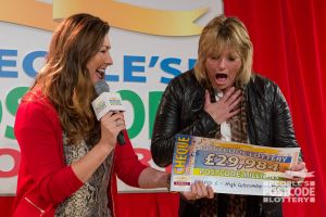 04. This winner was very pleased to see her cheque!