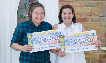 Mother and daughter Sharon and Katrina with their whopping £25,000 cheques