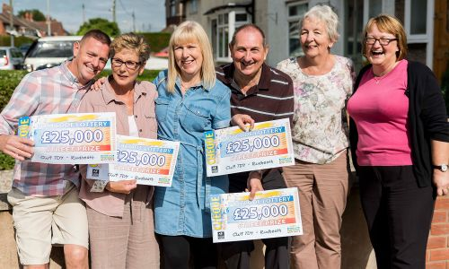 Lucky Rudheath winners with their fabulous £25,000 cheques