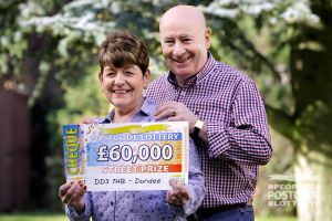 June and her husband Joe with their fabulous £60,000 cheque