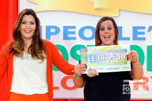 07. Michelle Harrison accepted the first of six big cheques on behalf of her mom Gail, who was on holiday
