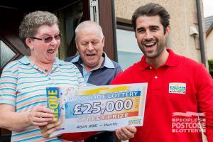Ecstatic winner Jean receiving her cheque from Matt Johnson