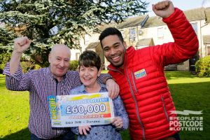 Lucky winner June was over the moon to receive £60,000 as she plays with two tickets