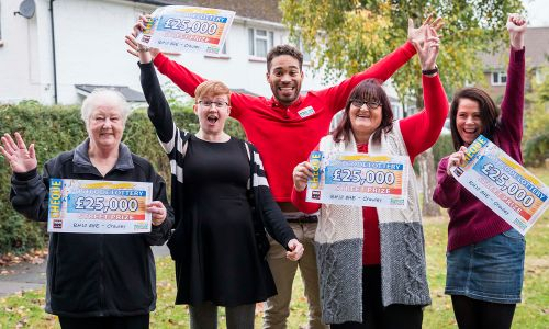 The lucky Crawley winners celebrating with Street Prize Presenter Danyl Johnson
