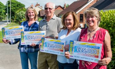 The four lucky winners from Knott-End-on-Sea with their £25,000 cheques