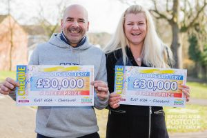 Both of the lucky Cheshunt winners and their £30,000 cheques