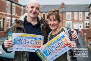 Neighbours Dominic and Keely with their fabulous cheques