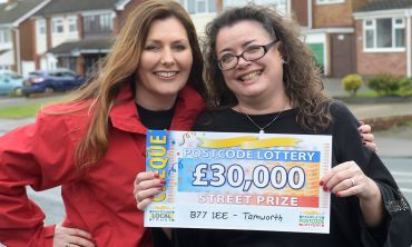 One of the lucky Tamworth winners, Lisa, with her £30,000 cheque