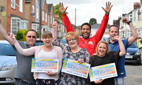 Three Wellingborough players proudly celebrate their £25,000 wins with People's Postcode Lottery Ambassador Danyl Johnson