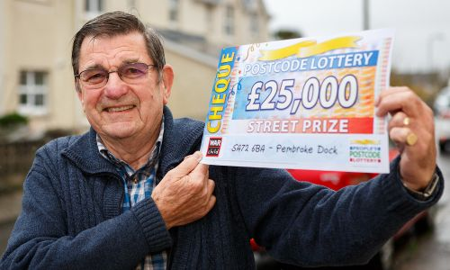Pembroke Dock winner William was pleased to receive his fabulous £25,000 cheque
