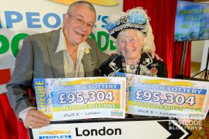 Winner Jo with his Pearly Queen friend Dee, and his whopping £190,608 prize money